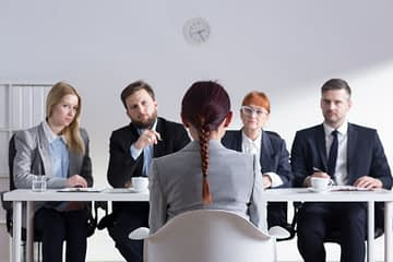 51793960 - woman during job interview and four elegant members of management